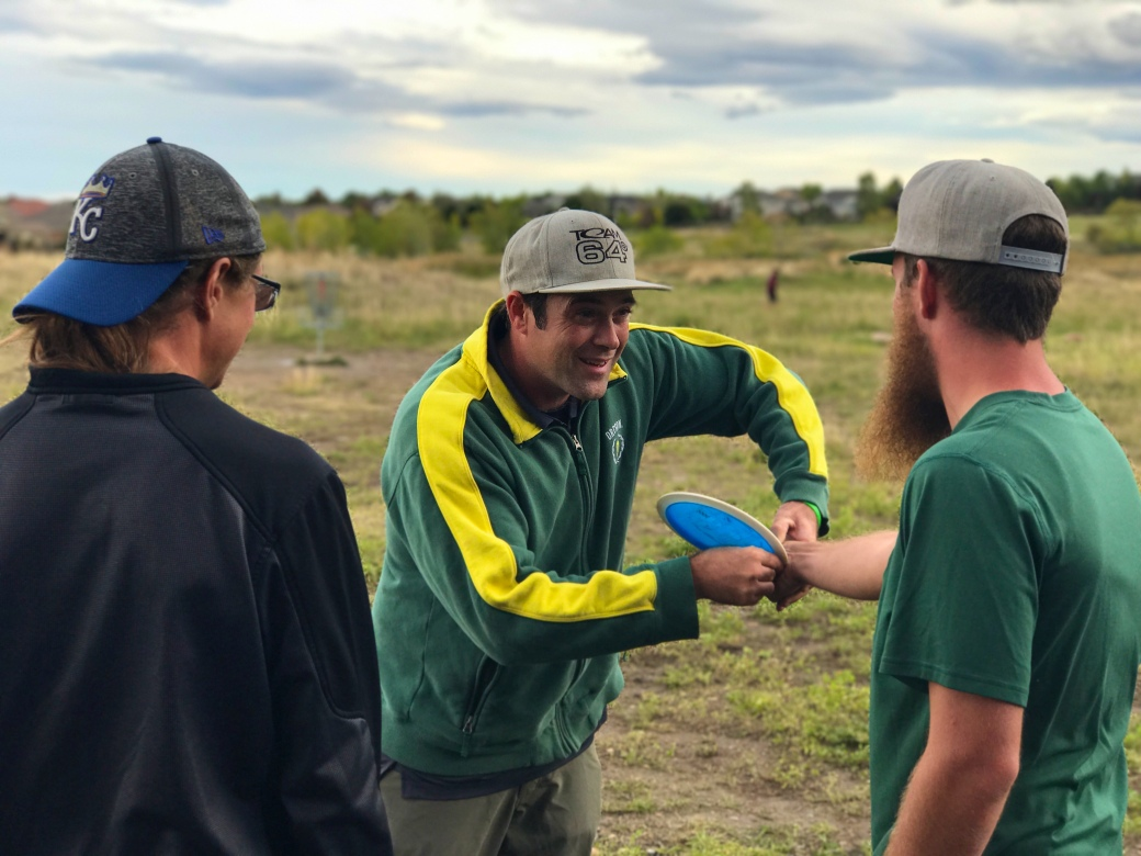 1ab9d7cb3c3bc Dave Feldberg instructs Tyler Jessop (right) and Mitchell Rand (left) at  the Birds Nest disc golf course in Arvada