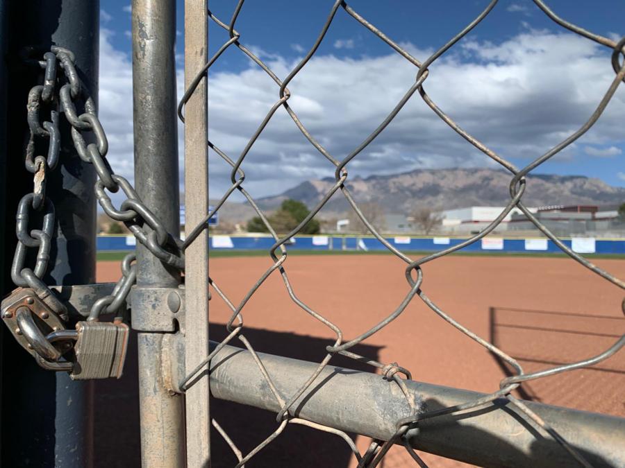 Cover art A baseball dimond behind a locked gate. Photo Robert Rosales
